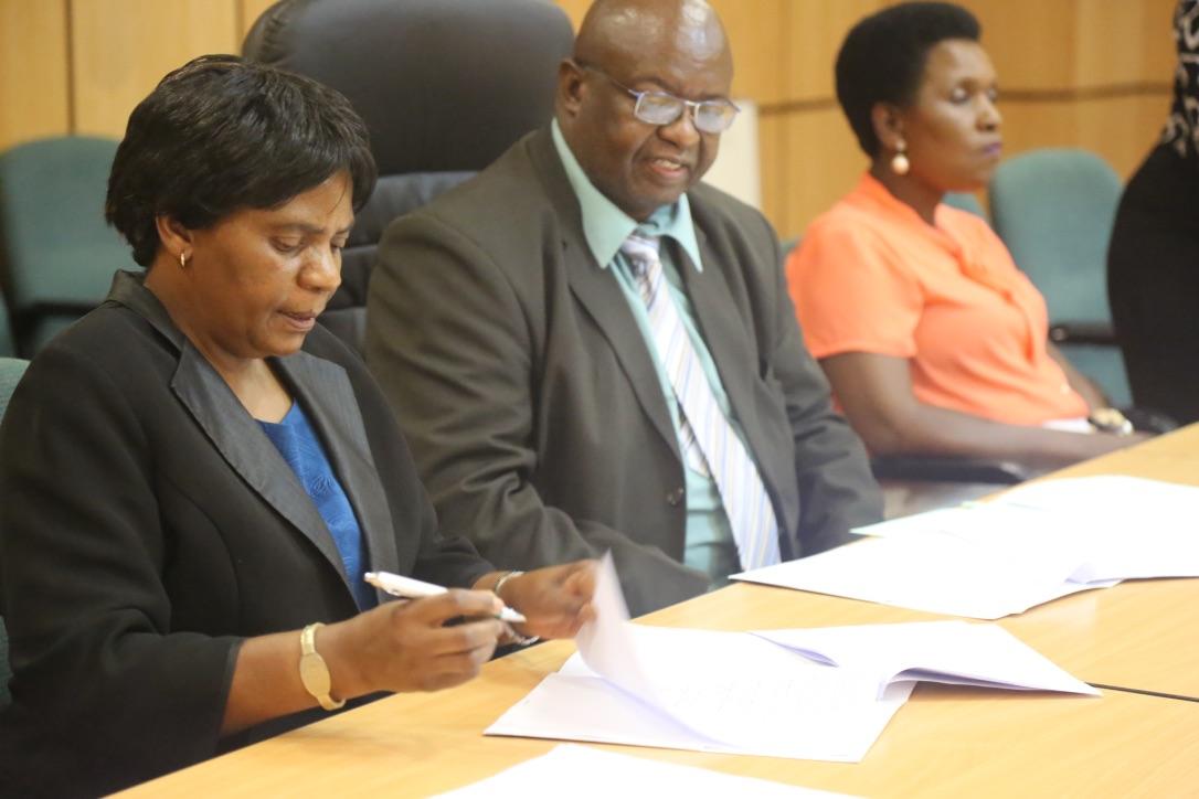 Mrs Muzite signing the MOU